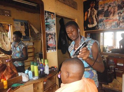 Kiyinji in his saloon working on a customer