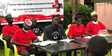 Kyambogo University Guild President John Mbaziira (C) during the presser