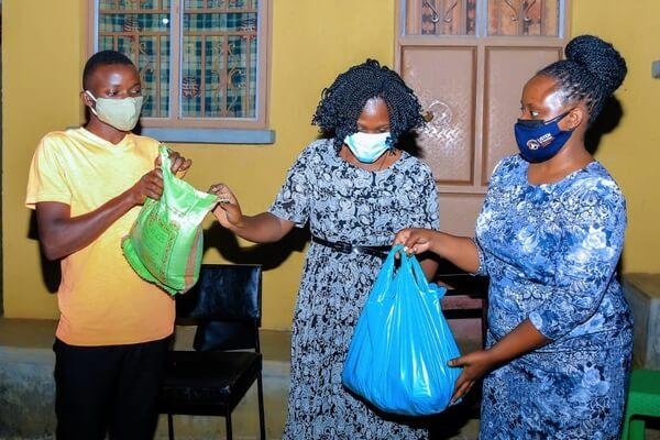 Hon Midius Natukunda Kaharata (Middle) delivering packages to BSU students
